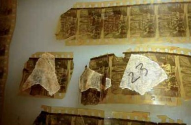 The Badly damaged print during restoration